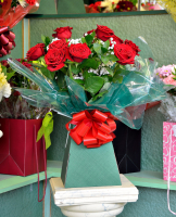 Say it with flowers - A dozen quality red roses from Christine's Florists just £40