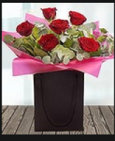 FREE box of chocolates with ever bouquet of Valentine's Flowers!