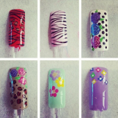 Beautiful hand painted nail art at Serenity!