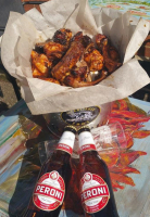 A Bucket of Ribs & Wings + 2 Drinks.