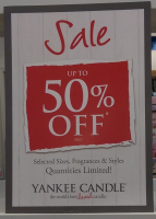 UP TO HALF PRICE ON YANKEE CANDLES