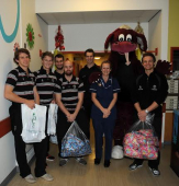 Somerset Players Deliver Christmas Presents to Children's  Ward.