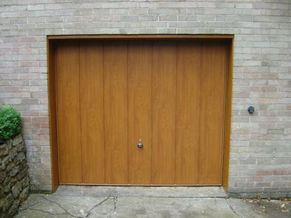 Andy jordan the garage door man installation and repairs for Man door in garage door