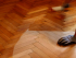 What is the best way to clean a hardwood or parquet floor?
