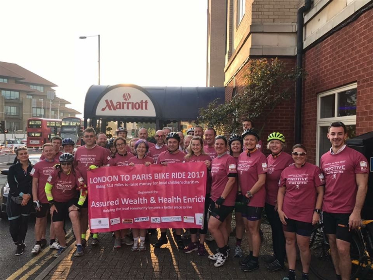 STAFF FROM WARRINGTON YOUTH CLUB 'GET ON THEIR BIKES' FOR CHARITY