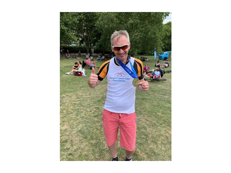 Ride to Victory: Motor Man Celebrates Success at Charity Bike Ride