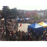Hitchin's Market Place is crowded in the sunshine