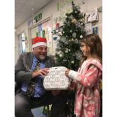 Kingston Mayor delivers Christmas gifts to children in hospital