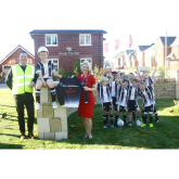 REDROW HELPS JUNIOR FOOTBALL TEAM KICK OFF FIRST SEASON IN NEW KITS