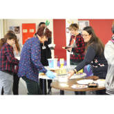 Carols, cake and charitable raffle at Richmond upon Thames College for Shooting Star Chase