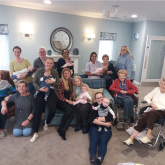 Once upon a time in Sutton Coldfield – local care home welcomes three generations for story time and massage