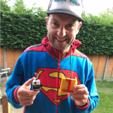 Plumbing tutor completes marathon in his back garden to raise money for charity